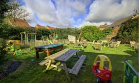 The outdoor area of the Wombourne Pool Bar, with a large beer garden that catches the sun.