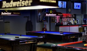 Pool Tables with Budweiser lights.