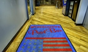 The Wombourne Pool Bar welcome mat with American flag.